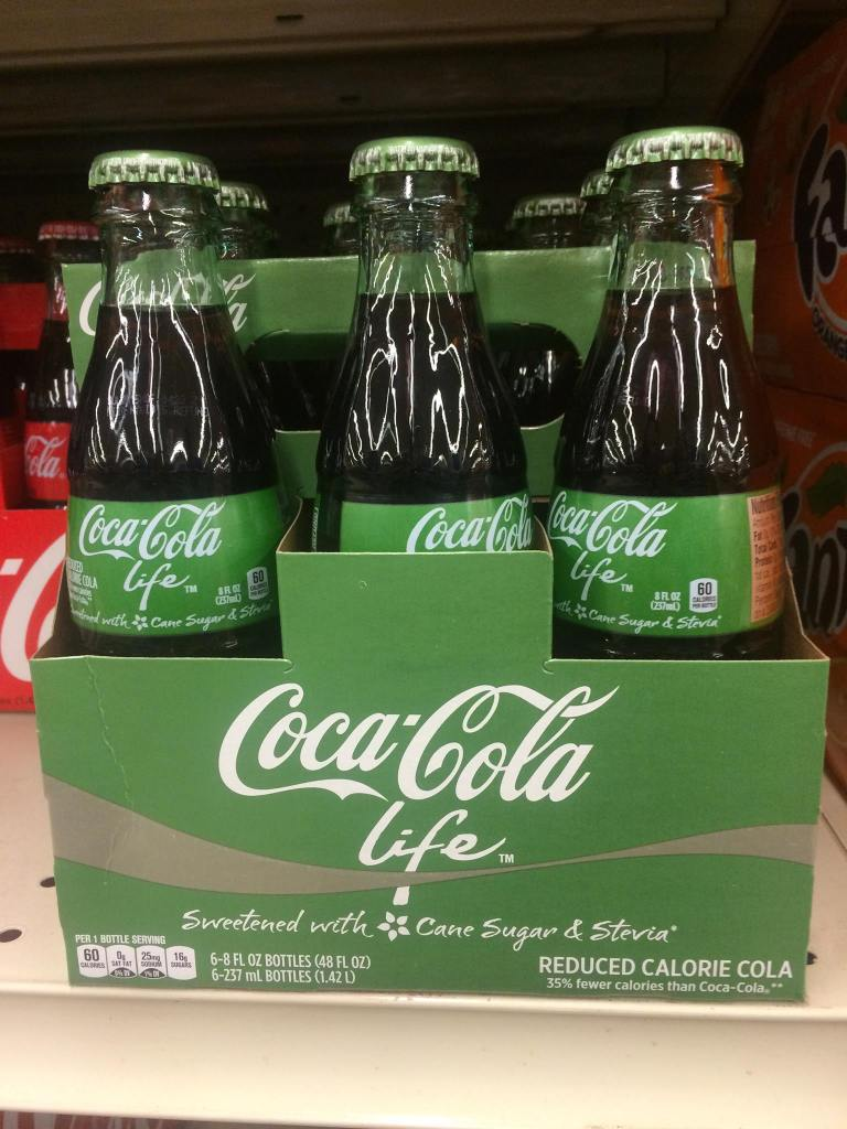 ife of coca cola Coca-cola life -- a reduced-calorie cola sweetened with cane sugar and stevia leaf extract -- is the perfect refreshing beverage to enjoy throughout summer's sweetest moments and pairs well with some of your favorite seasonal dishes.